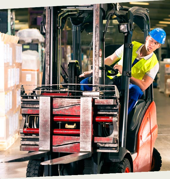 Man-Driving-Forklift-With-Hardhat